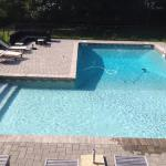 """L""-shaped pool with full length step in shallow end and auto-vacuum cleaning while you watch."
